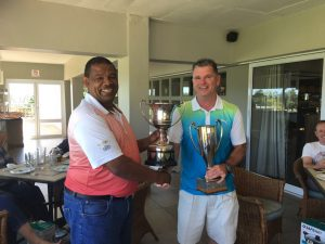 Peter Sproul winning the Distell Golf Championship nett and gross trophies